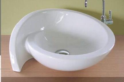 כיור מונח לחדר אמבטיה 7000. כירם מונח/כיור שולחנים.  מידןת: 52X44  כיור מונח בצורת כונכיה  צבע: לבן מבריק