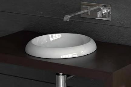כיור מונח לחדר אמבטיה 7100. כיור שולחני קוטר 41  מגיע בצבעים: כתום מבריק, שחור מט, ירקרק מבריק, ברונזה מטאלי, סילבר מטאלי.