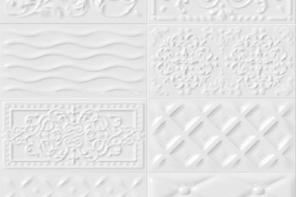 אריחי וינטג' לחיפוי קיר מסדרת Castello C520. דקור תבליט מעורב לבן.  גודל 20*10.