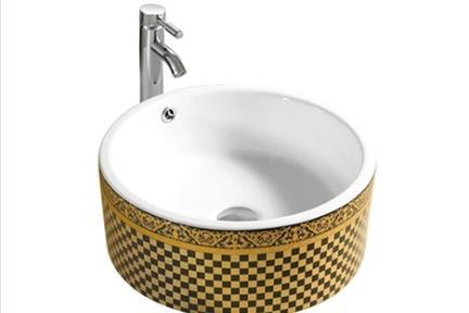 כיור מונח לחדר אמבטיה L421. כיור מונח עגול פנים לבן, חוץ דומינו שחור-זהב  קוטר: 42*42  גובה: 16
