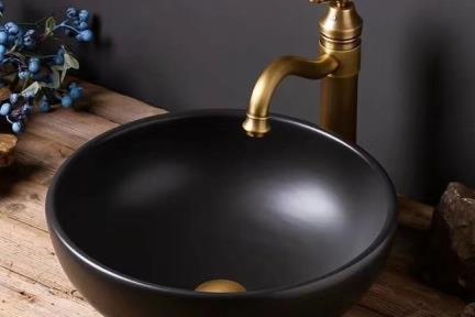 כיור מונח לחדר אמבטיה L4005. כיור קרמי עגול מונח בצבע פחם.  קוטר: 40  גובה:14.  אין לנו את הברז שבתמונה אלא רק את הכיור.