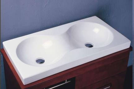 כיור מונח לחדר אמבטיה L333. כיור מעל משטח  חלקו שקוע במשטח  מידה: 89X43  צבע: לבן  מגיע עם 2 חורים במרכז לברזים
